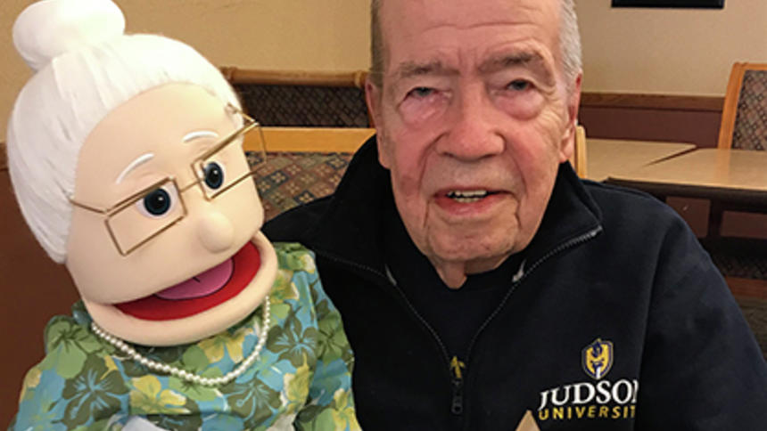 Craig Stewart poses with his reminiscence program puppet, Carla, at Ecumen Meadows in Worthington.