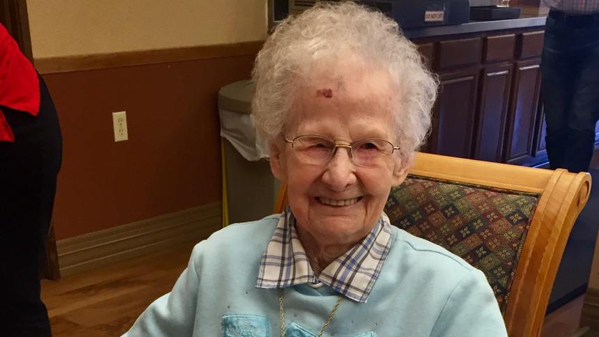 Lecil Arends poses with her 105th birthday cake at Ecumen Meadows in Worthington.